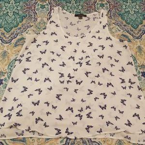 White sleeveless sheer blouse